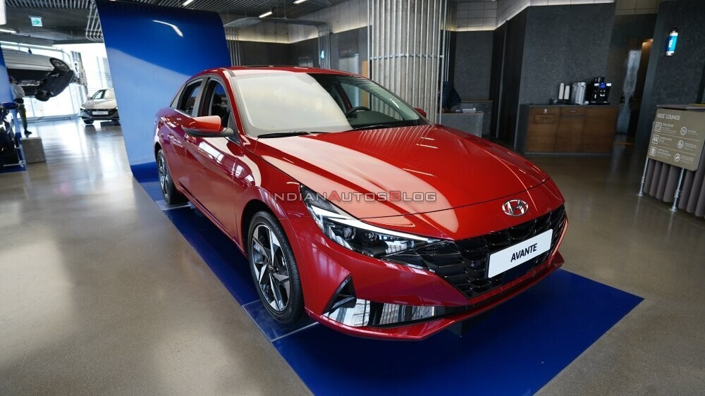 2021-hyundai-elantra-red-front-three-quarters-8ee0.jpg
