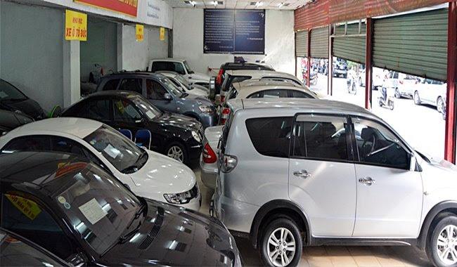 Đại gia ôtô lỗ nặng: Đóng showroom, đi bán nước ngọt, quần áo - Hình 1