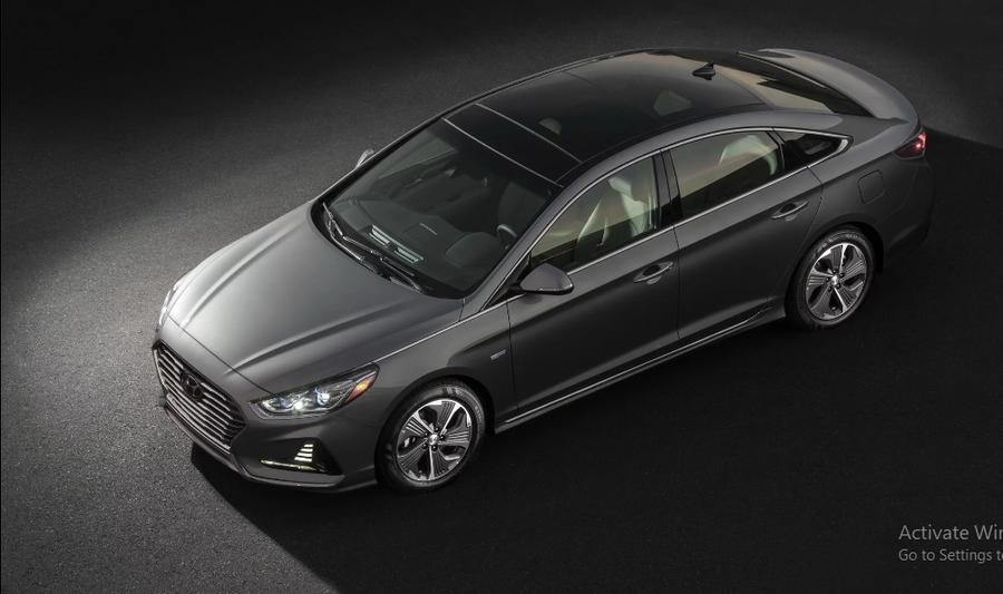 Hyundai Sonata Hybrid 2018 cập nhật nhiều trang bị dù giảm giá bán - Hình 1