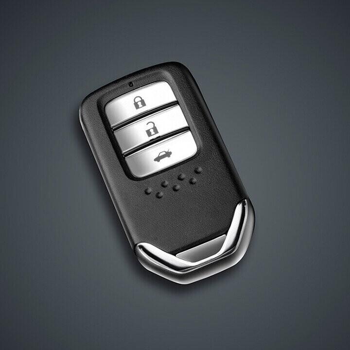 Chìa khóa thông minh tích hợp nút mở cốp